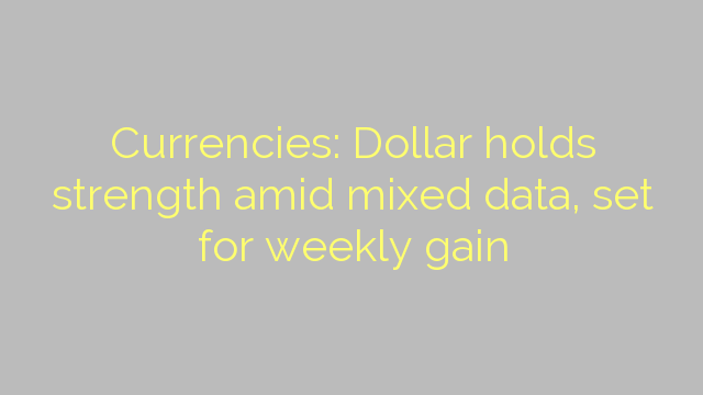 Currencies: Dollar holds strength amid mixed data, set for weekly gain